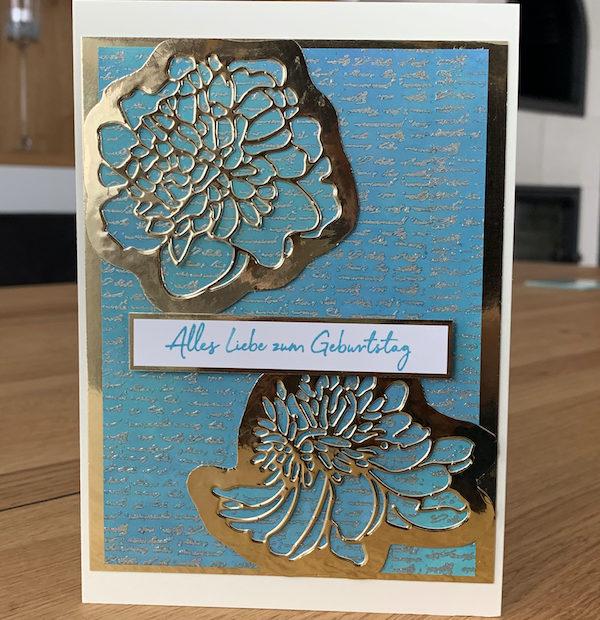 Geburtstagskarte in türkis mit goldenen Blumen